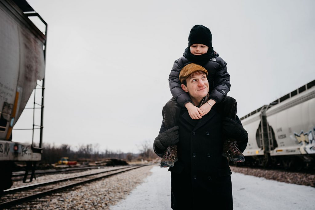 Axel and his dad playing at the train station for giraffe and platypus family shoot