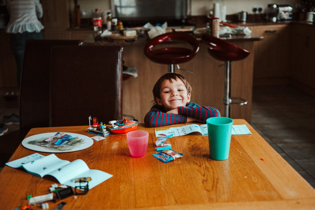 Little boy smiling at the kitchen table
